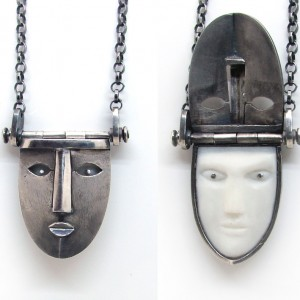 mask pendant with secret locket and silver necklace