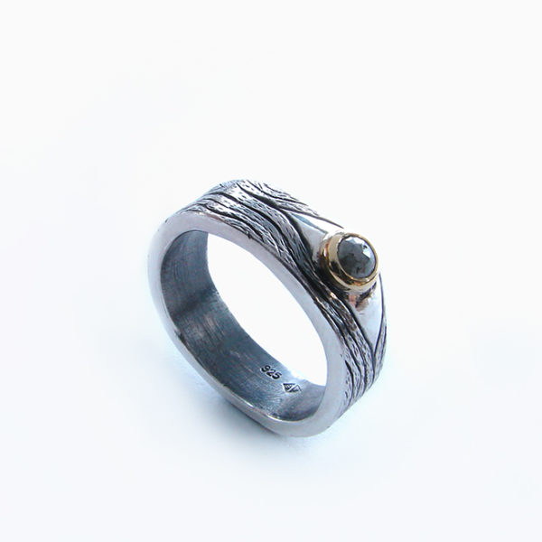irregular silver band with rose cut diamond set in yellow gold
