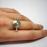 poetic playful silver ring