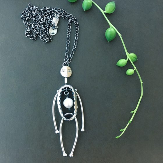 puppet pendant, silver and pearl