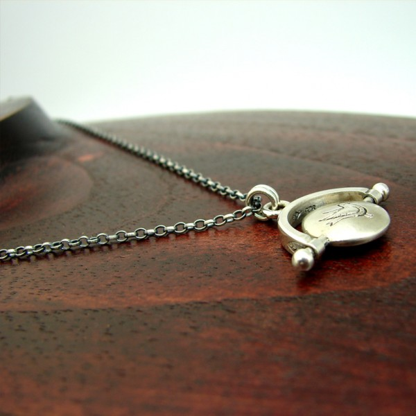 silver thaumatrope pendant