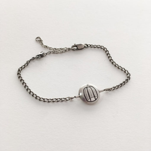 thaumatrope bracelet bird and cage