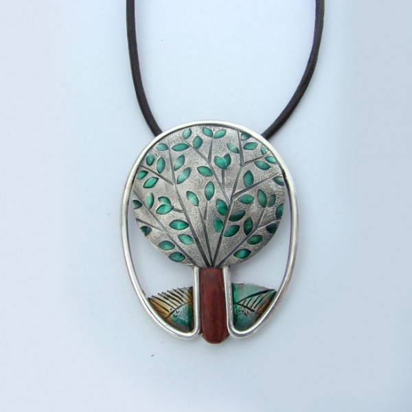 silver and wood pendant