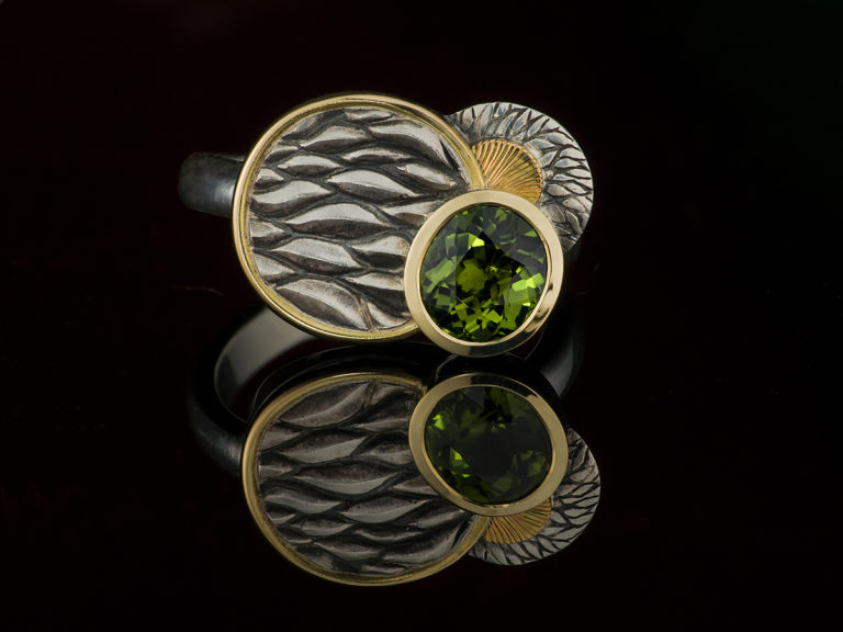 peridot ring in silver and gold