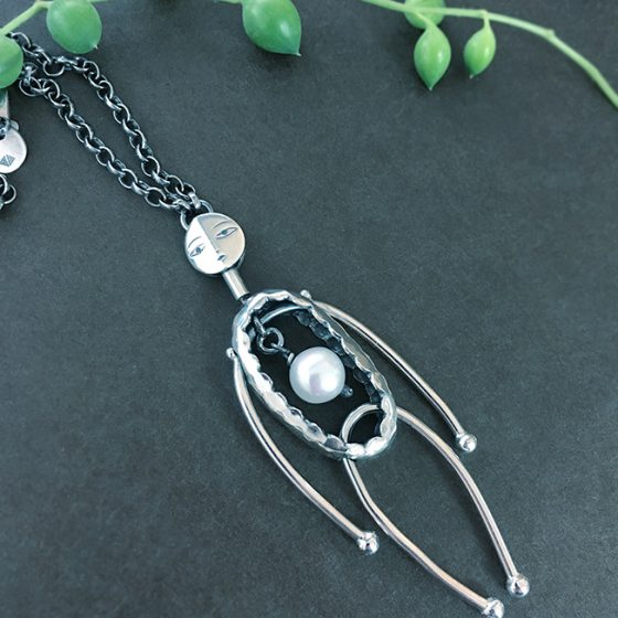 articulated character pendant