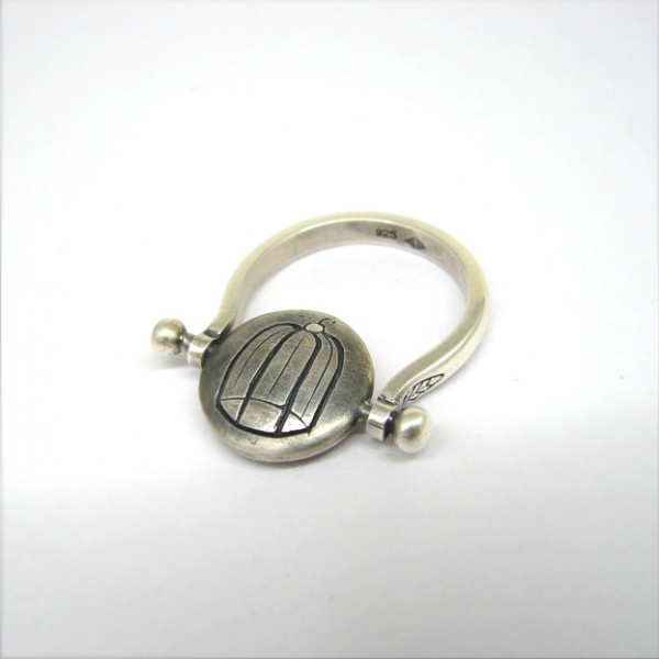 silver birs and cage ring