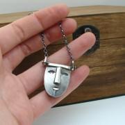 silver mask pendant
