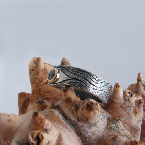 modern engagement ring , wide irregular band, silver gold and diamond