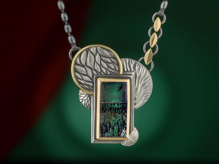 quartz pendant in silver and gold